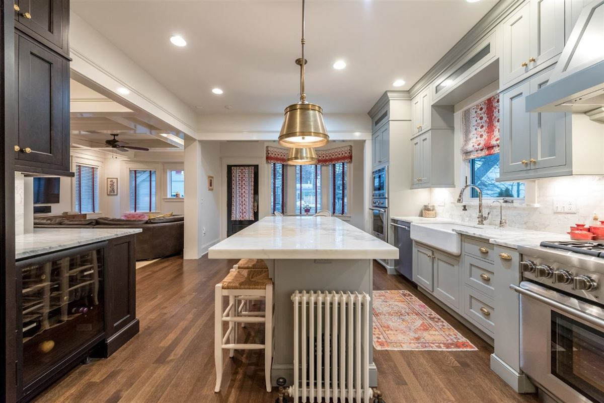 Luxury real estate renovated and updated 1894 Queen Anne Victorian