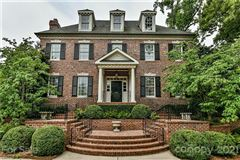 Elegant brick Georgian on manicured private lot luxury properties