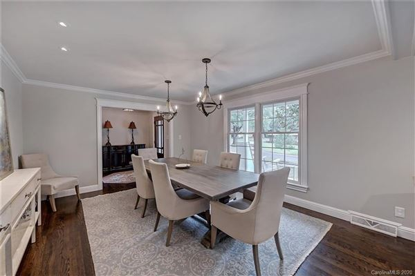 Luxury homes a light filled open floor plan with wood floors through out