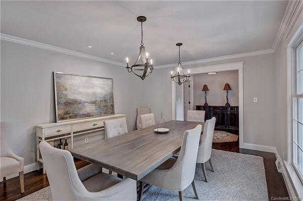 Luxury real estate a light filled open floor plan with wood floors through out