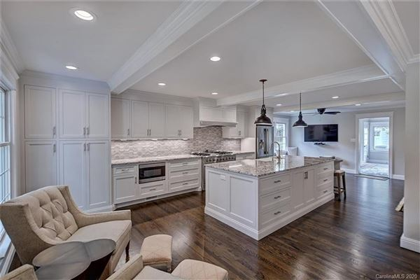 Luxury properties a light filled open floor plan with wood floors through out
