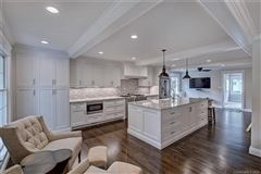 Mansions a light filled open floor plan with wood floors through out
