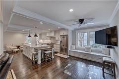 Luxury homes in a light filled open floor plan with wood floors through out