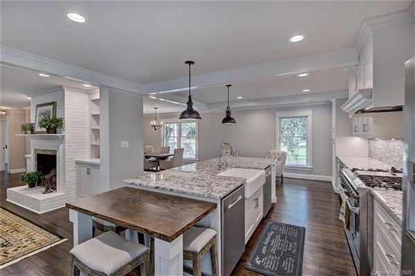 a light filled open floor plan with wood floors through out  mansions