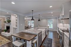 Mansions in a light filled open floor plan with wood floors through out