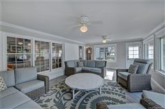 a light filled open floor plan with wood floors through out  luxury homes