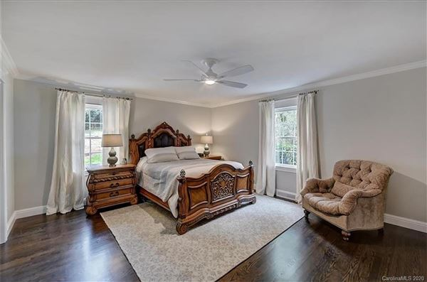 a light filled open floor plan with wood floors through out  luxury properties