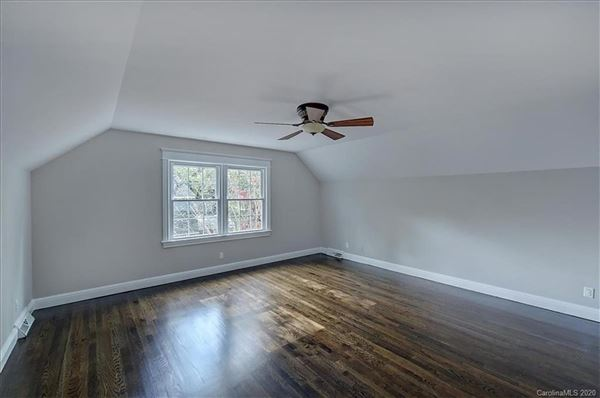 a light filled open floor plan with wood floors through out  luxury real estate
