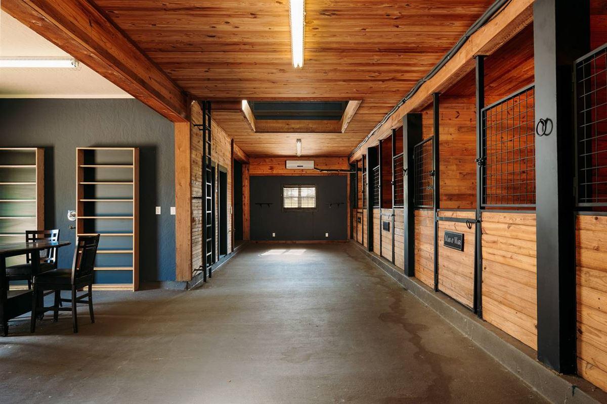 masterfully designed estate on 64 acres luxury real estate