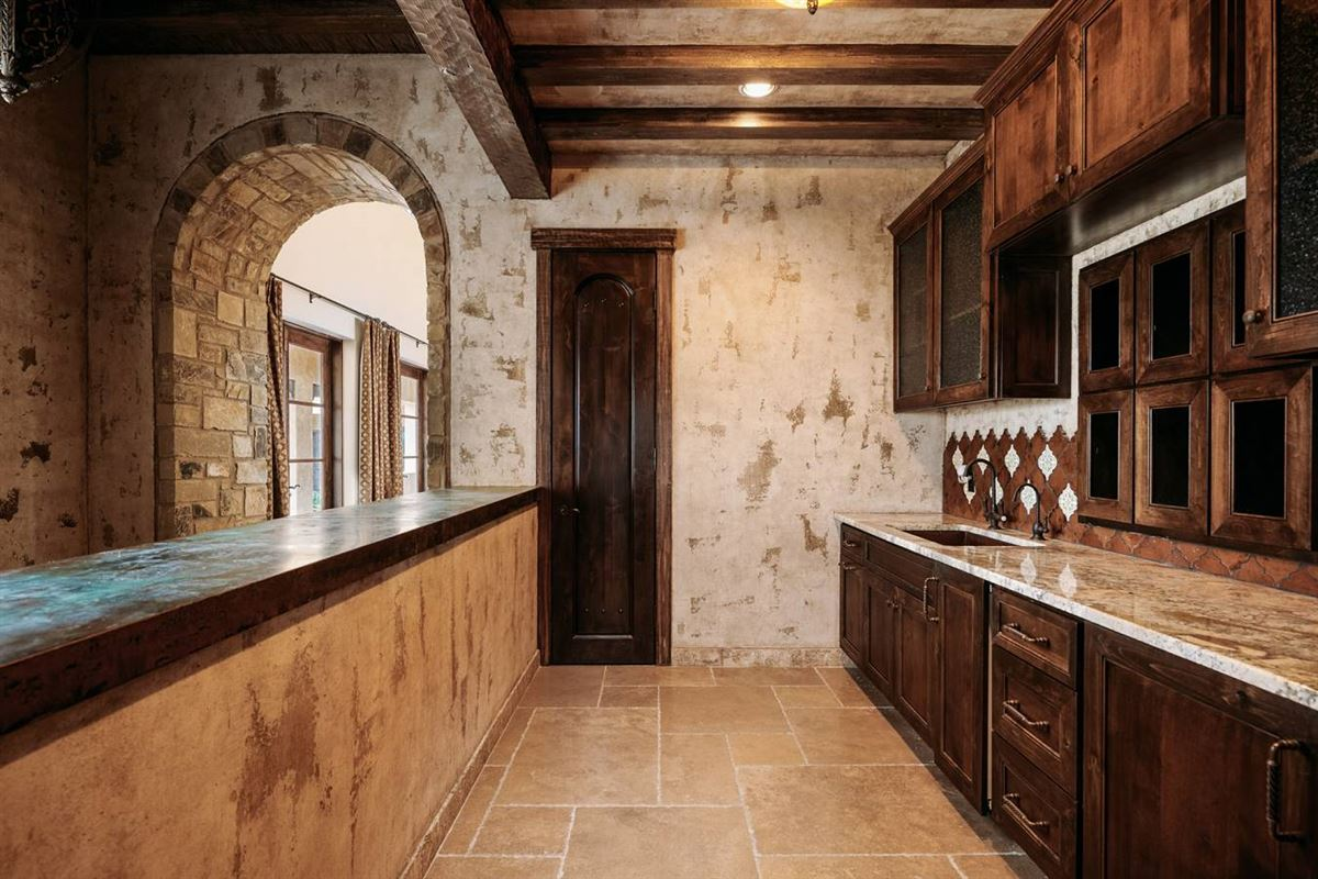 masterfully designed estate on 64 acres luxury properties
