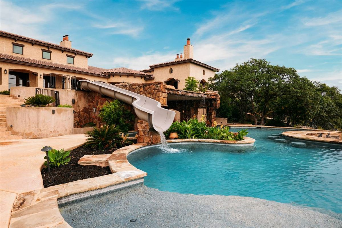 masterfully designed estate on 64 acres luxury homes