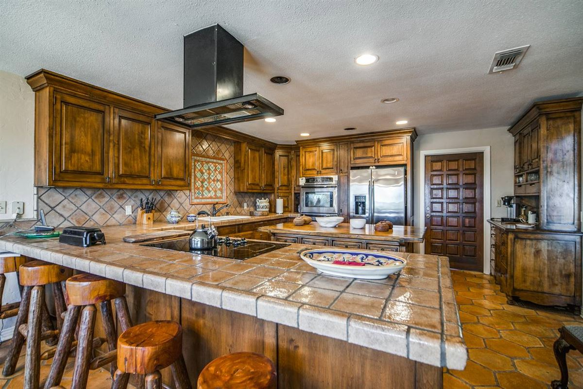 Mansions in approximately 25 acres of fantastic Hill Country living