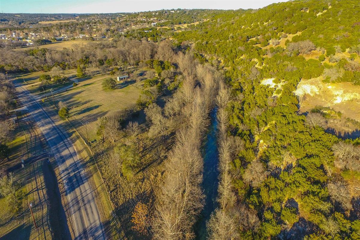 Luxury real estate approximately 25 acres of fantastic Hill Country living