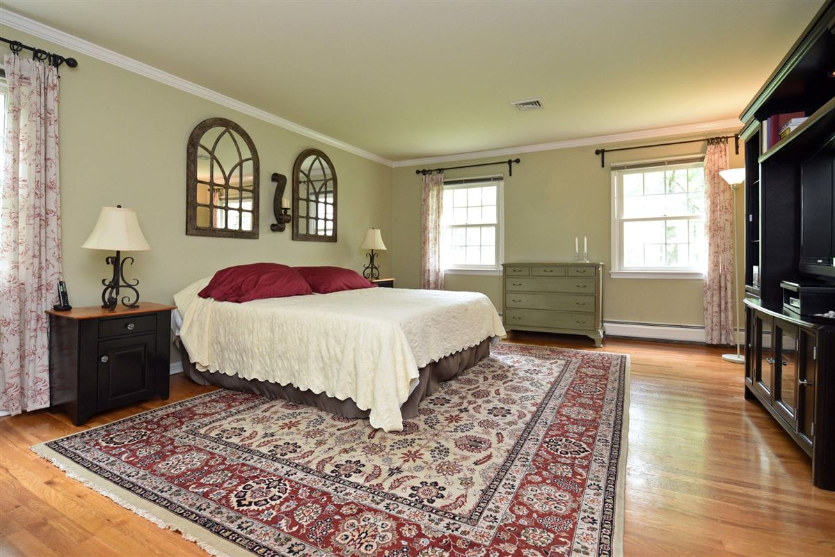meticulously maintained center hall colonial mansions
