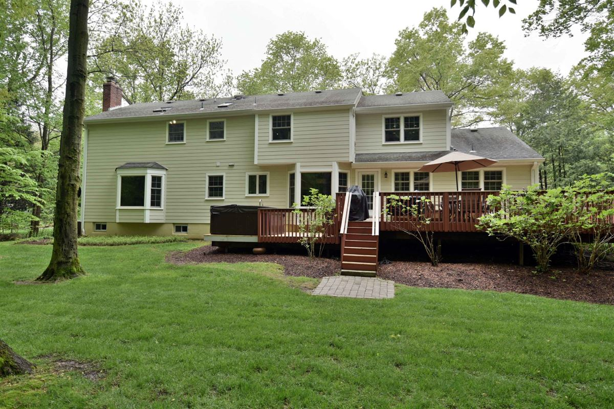 Mansions in meticulously maintained center hall colonial