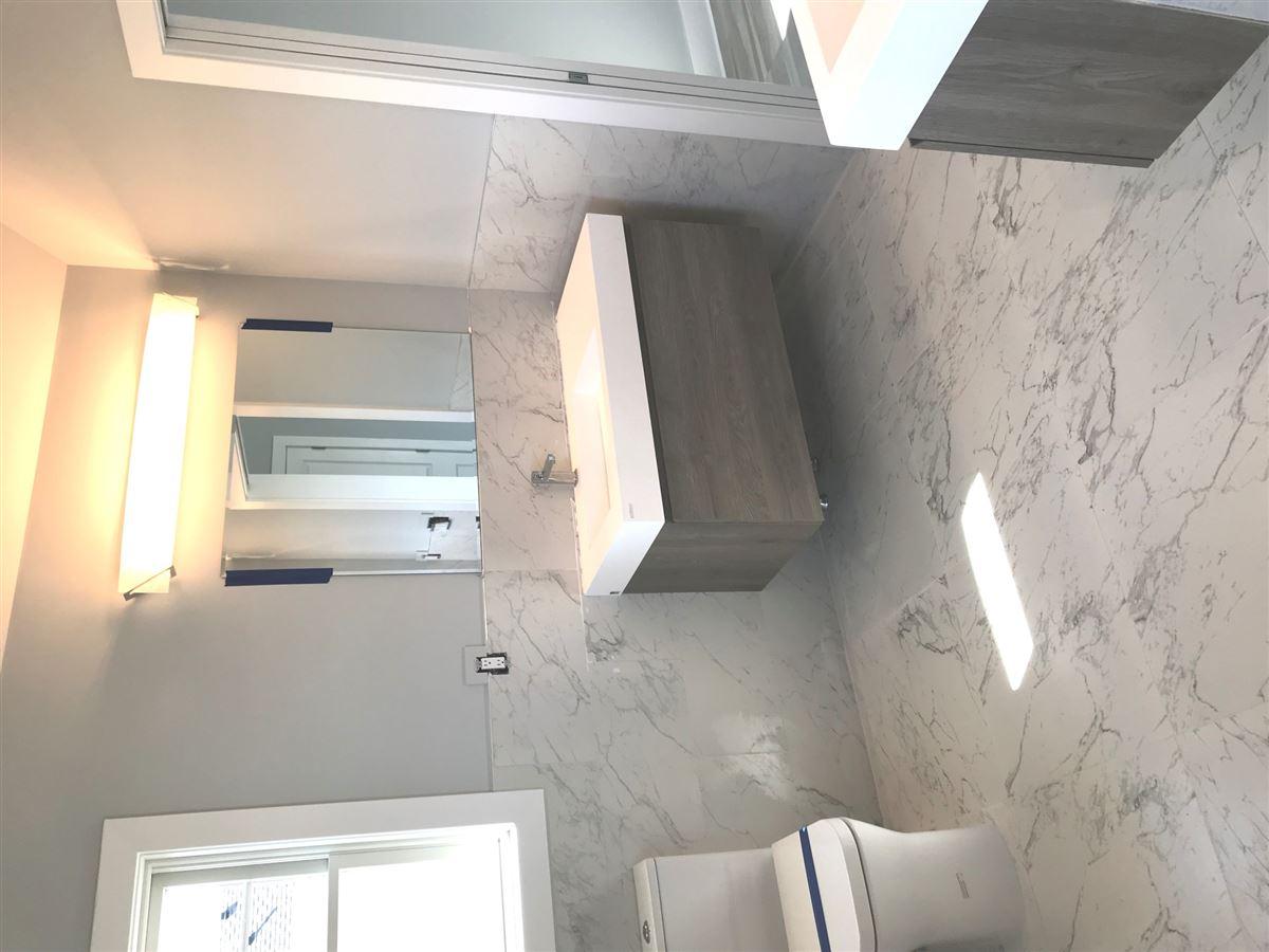 new construction reverse living beach house luxury properties