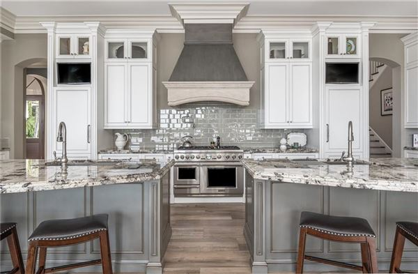 completely renovated estate in sought after enclave luxury homes