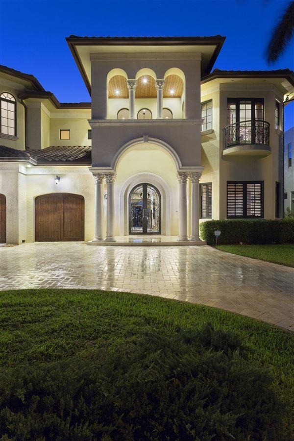 Luxury homes Custom built Tuscan inspired waterfront estate