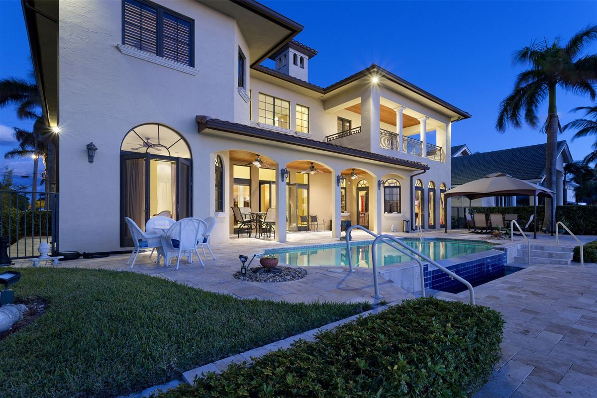 Luxury homes in Custom built Tuscan inspired waterfront estate