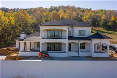 Incredible custom home in popular Cartwright Close luxury properties