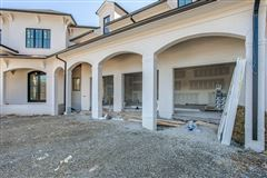 Incredible custom home in popular Cartwright Close luxury homes
