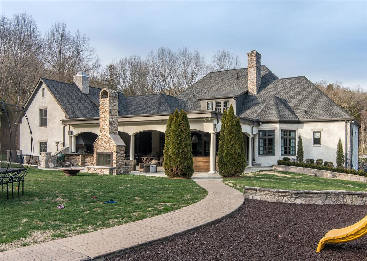 Exclusivity meets convenience in Forest Hills mansions