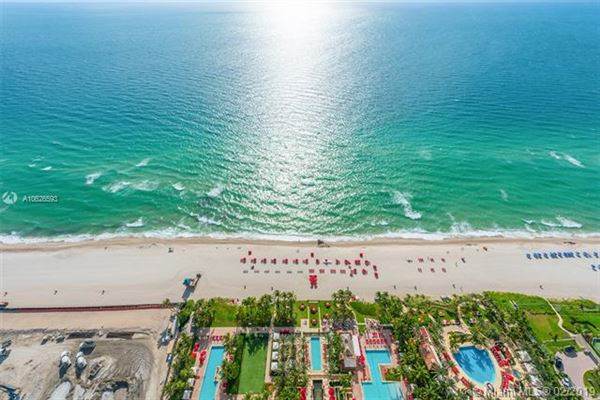 Luxurious penthouse in exclusive Acqualina Residence and Resort mansions