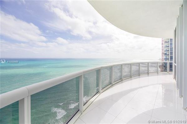 Luxury homes in beautiful unit with direct ocean wraparound balcony