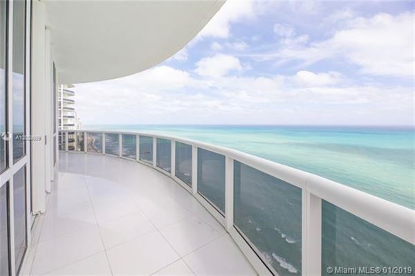 Luxury properties beautiful unit with direct ocean wraparound balcony