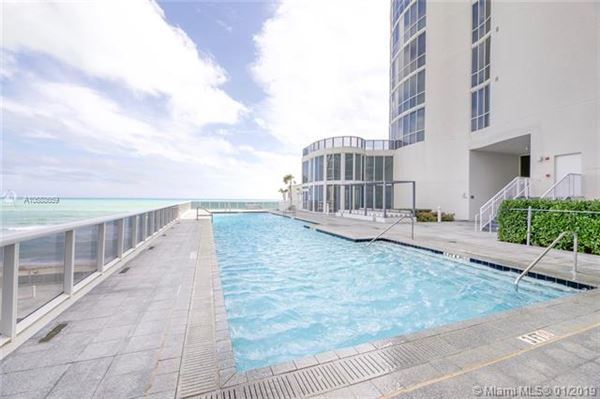Luxury homes beautiful unit with direct ocean wraparound balcony