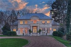 Luxury homes in French Baroque estate on private wooded property