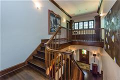 Renovated Tudor-style home mansions