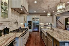 Luxury homes in beautiful custom home in popular Davidson Wood