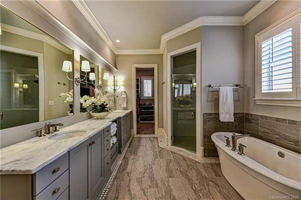 Luxury properties beautiful custom home in popular Davidson Wood