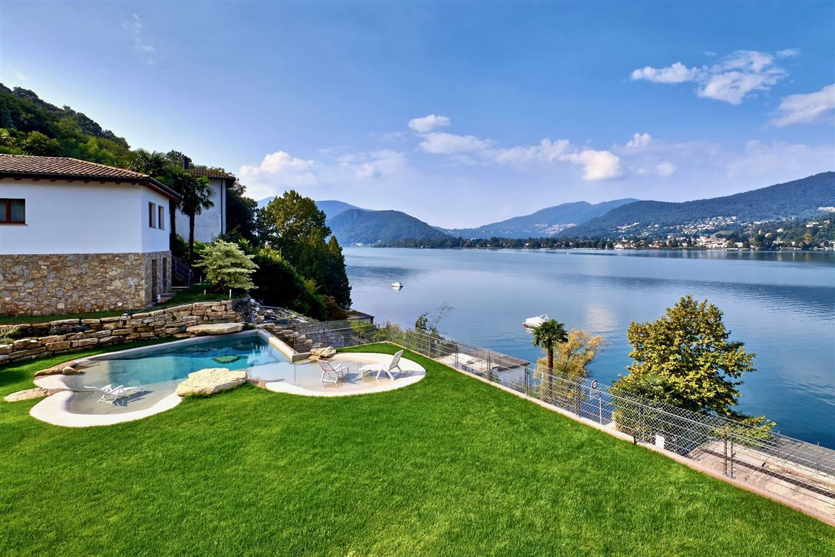 Luxury real estate a majestic lake front home in montagnola