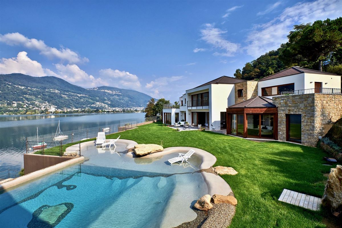 Luxury properties a majestic lake front home in montagnola