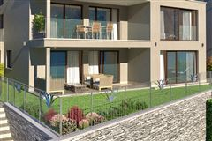 Mansions luxurious garden apartment is for sale in Minusio