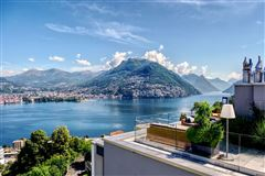 Mansions luxury duplex-penthouse with views in paradisO SWITZERLAND