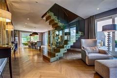 Luxury homes in luxury duplex-penthouse with views in paradisO SWITZERLAND