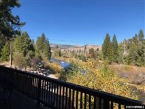 Mansions in a private wooded paradise along the truckee river