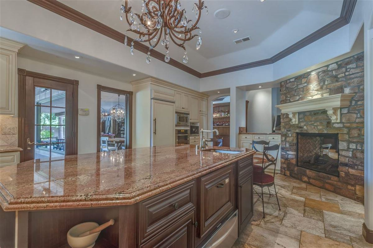 gated estate on almost 2 acres luxury properties