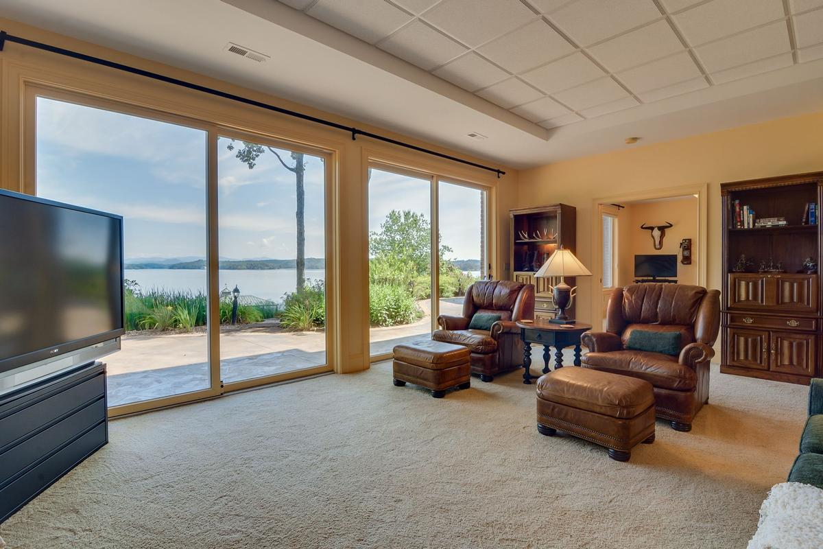 Luxury properties waterfront home in peaceful mountain view setting