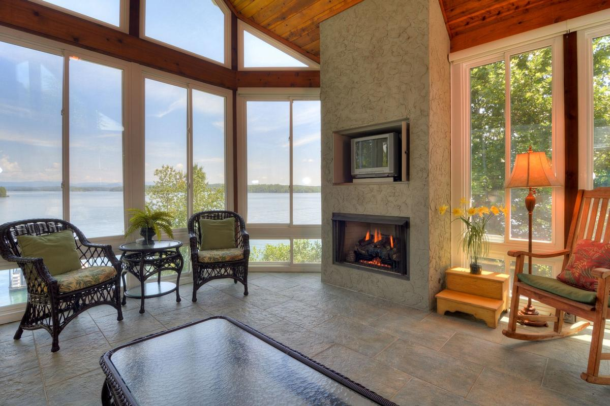 Luxury real estate waterfront home in peaceful mountain view setting