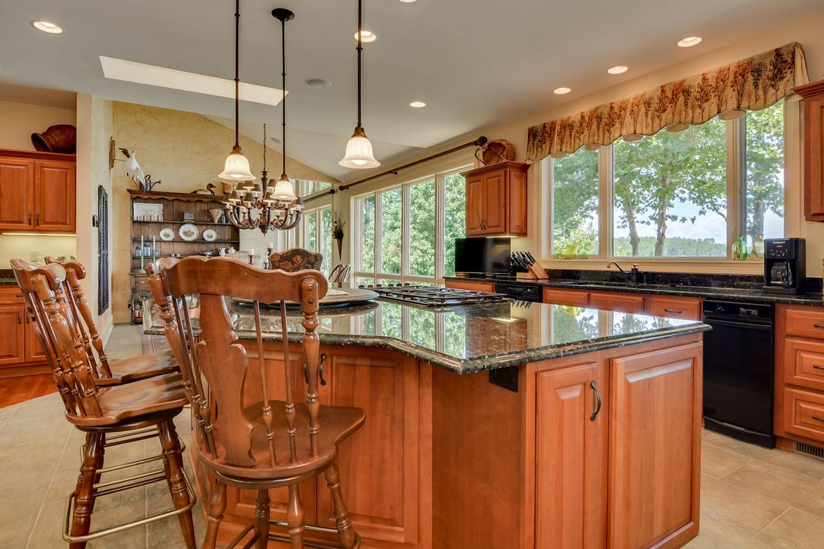 Luxury homes waterfront home in peaceful mountain view setting