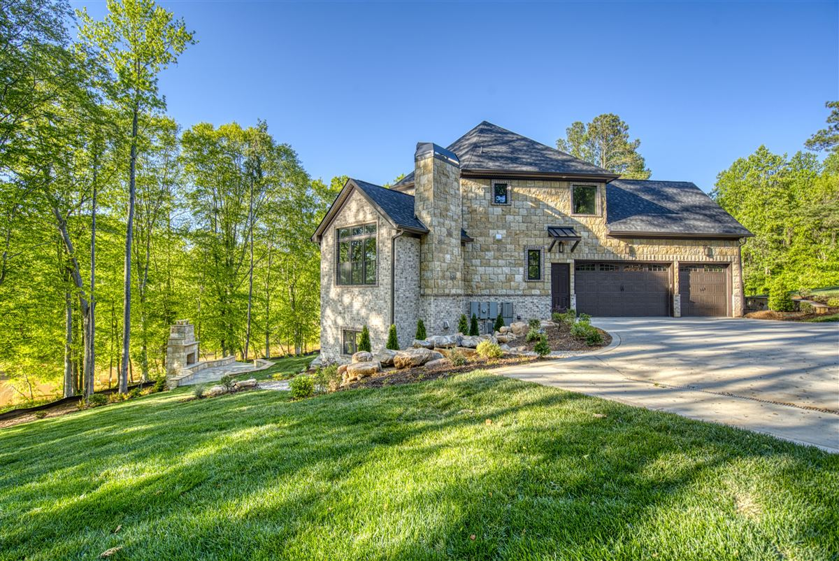 Luxury real estate Gorgeous new limestone waterfront home