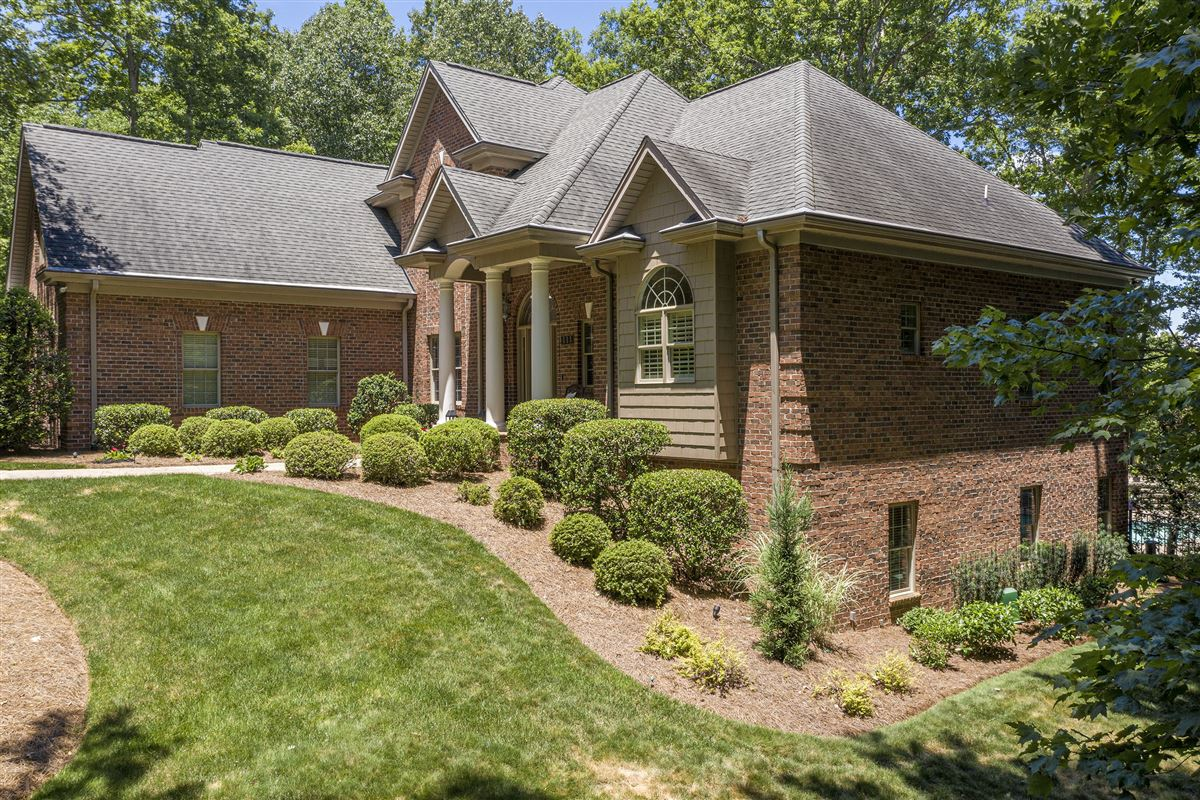 this immaculate home is nestled in a peaceful setting with lake access luxury homes