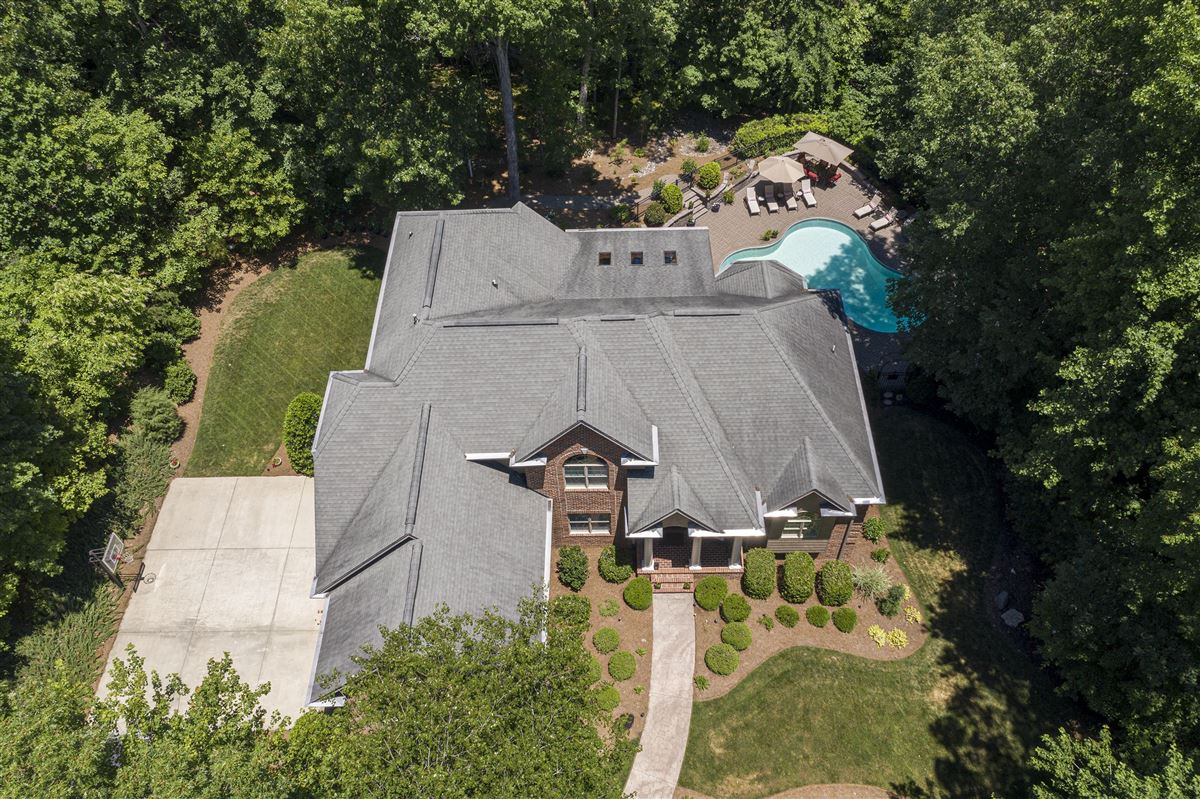 Luxury real estate this immaculate home is nestled in a peaceful setting with lake access