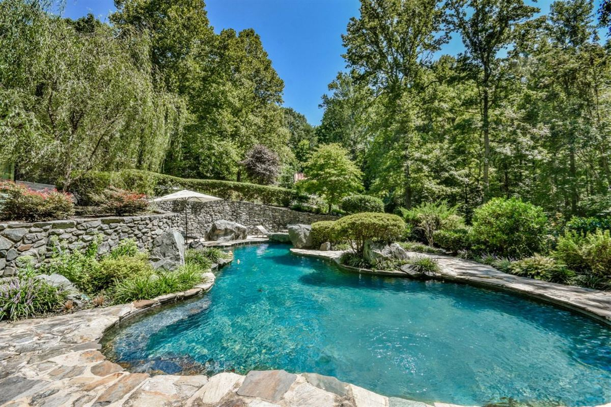 Luxury real estate an enchanting property in a private wooded setting