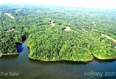 LARGEST PRIVATE UNDEVELOPED PROPERTY ON LAKE NORMAN luxury homes
