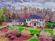 exquisite home SITUATED on two acres luxury properties
